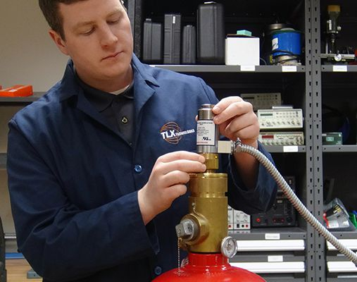 Solenoid engineer installing fire suppression valve